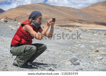 Woman shooting with a cellphone outdoors