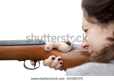 Woman shooting with air gun - isolated