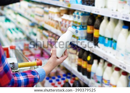 Woman shopping dairy product in grocery store