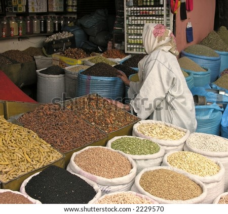 Woman shopping for spices in Moroccan souk