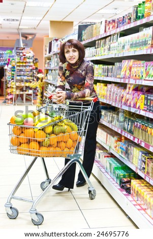 Woman shopping fruits in the supermarket