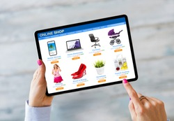 Woman shopping on online store by using tablet computer