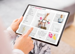 Woman shopping online at boutique fashion store