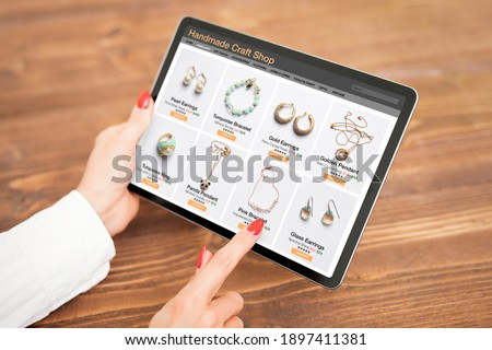 Woman shopping online for custom and hand made jewelry Foto stock ©