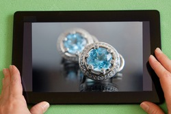 Woman shopping online for custom in jewelry internet shop, closeup