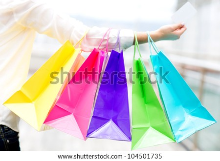 Woman shopping with a credit or debit card