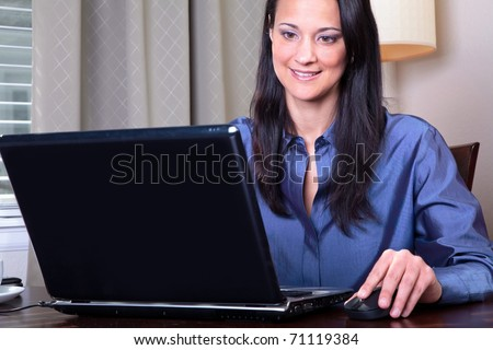 woman shops with her credit card online