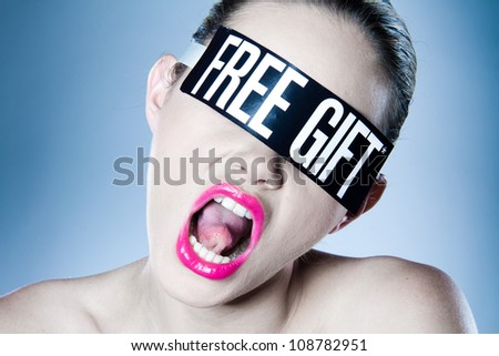 Woman shouting and wearing blindfold with text free gift.