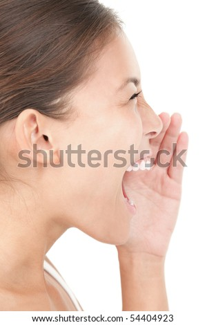 Woman shouting / screaming isolated portrait in profile. Asian woman Isolated on white background.