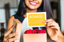 woman showing a bonus card