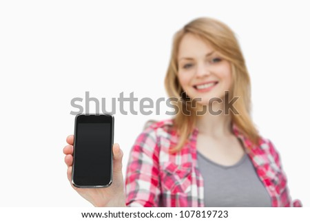 Woman showing a smartphone against a white background