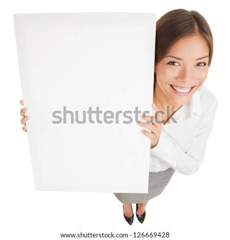 Woman showing a white board sign poster. High angle shot of attractive smiling woman with a blank white board isolated on white background. Mixed race Asian Caucasian business woman smiling happy.
