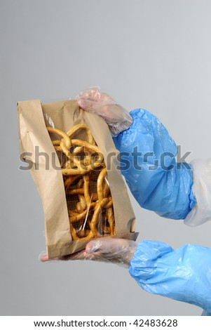 woman showing bag with food