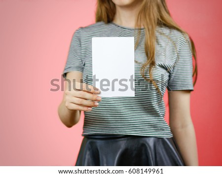 Woman showing blank white flyer paper. Leaflet presentation. Pamphlet hold hands. Girl show clear offset paper. Sheet template. Booklet design sheet display read first person. #608149961