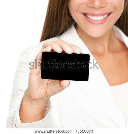 Woman showing business card. Young female professional executive smiling in white suit - closeup of business card.