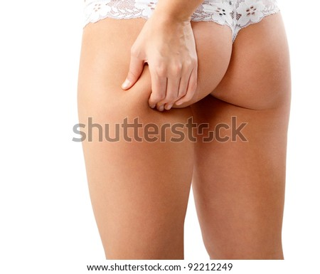 woman showing cellulite on her hips - stock photo