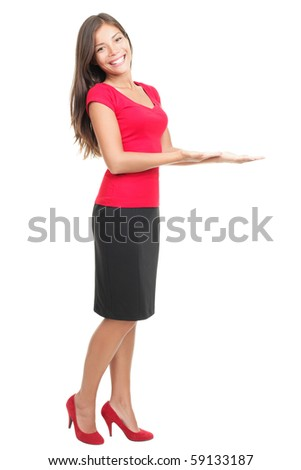 Woman showing / displaying copy space for your product / message. Isolated full body photo of young beautiful mixed Asian / Caucasian female model on white background.