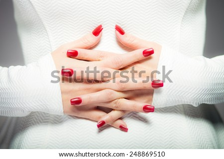 Woman showing her red nails, manicure concept