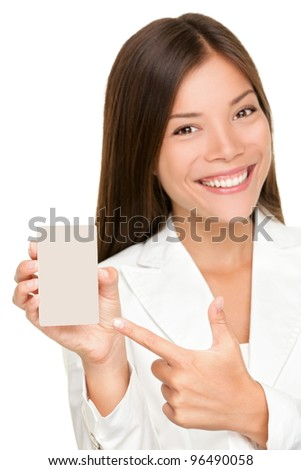 Woman showing holding blank sign. Replace with smart phone, mobile phone or copy. Smiling happy young business woman. Mixed race Caucasian / Chinese Asian female model isolated on white background.