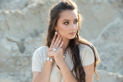 woman showing off her jewelery in fashion concept wearing accessories and jewelry