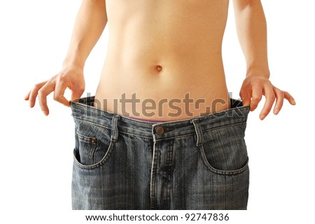 Woman showing off her weight loss - stock photo