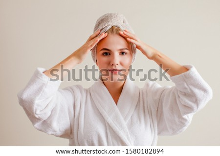 Woman showing system of exercises to improve skin. Spa, skincare and wellness concept