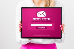 Woman showing tablet with newsletter signup page