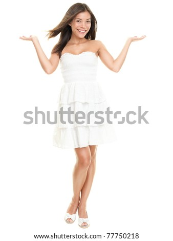 Woman showing with two open hands. Beautiful lovely girl in white summer dress isolated on white background in full body.