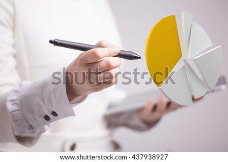 Woman shows a pie chart, circle diagram. Business analytics concept. #437938927