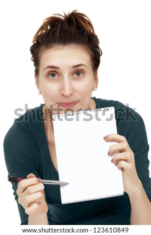 woman shows an entry in a notebook on a white background