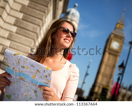 Woman sightseeing in London on a summer day
