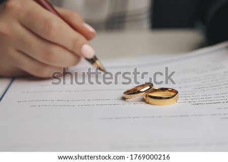 Woman signing marriage contract, closeup Foto stock ©