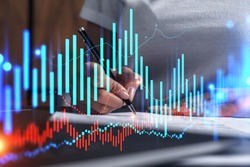 Woman signs agreement. Forex financil market chart and graph hologram. Double exposure . Brokerage concept.