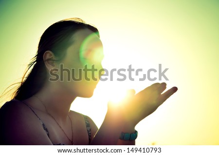 woman silhouette holding the sun