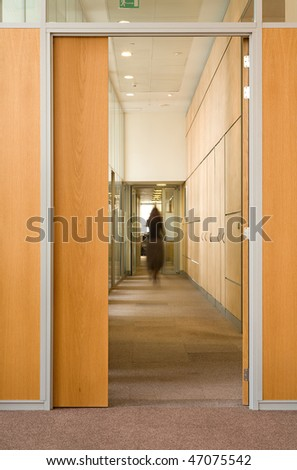 Woman silhouette in corridor of office building