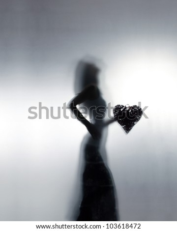 Woman silhouette with a big heart