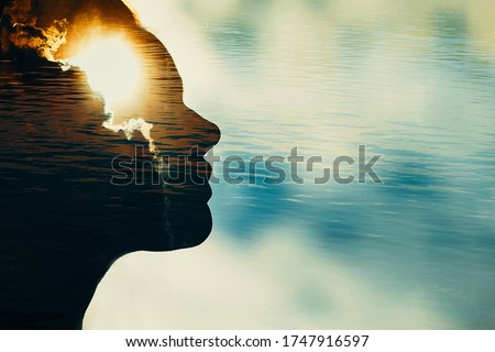 Photo of Woman silhouette with sun in head with copy space. Multiple exposure image.