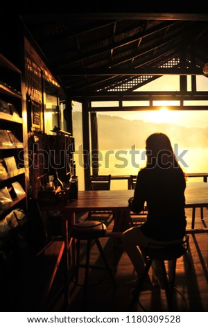 Woman Sit and Relax with Beautiful View  at the Antique Bar in The Morning #1180309528