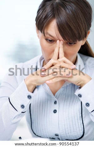 woman sits and pondering collecting fingers forehead
