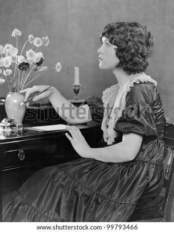Woman sits at desk