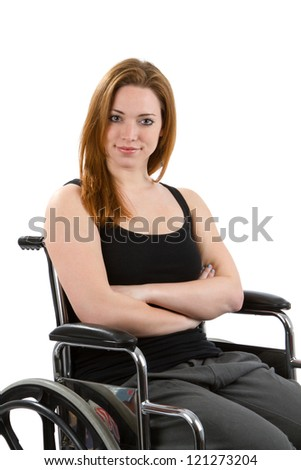 Woman sits confidently in wheelchair with arms crossed.
