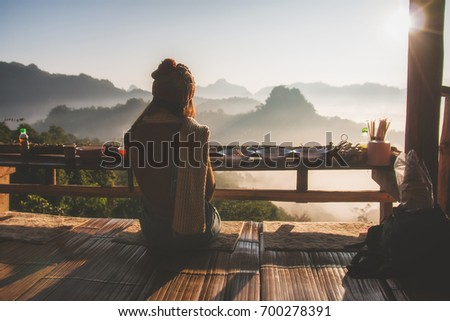 woman sitting and relaxing in Thai restaurant with enjoying sunrise #700278391