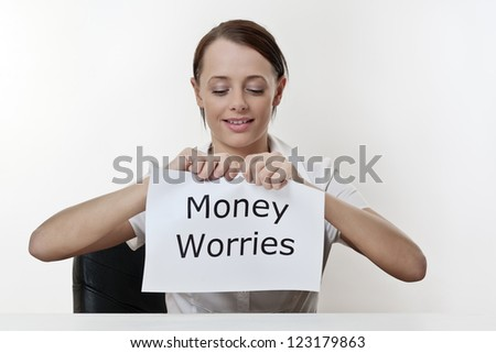 woman sitting at a desk about to get rid of all her money worries