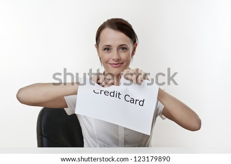 woman sitting at a desk getting rid of her credit card worries