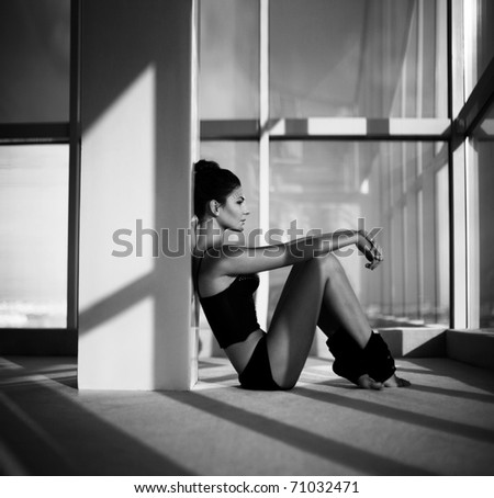 Woman sitting by a window having a rest. indoor shot