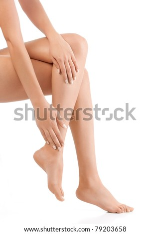 woman sitting down showing only legs and hands