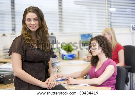 Woman sitting happily on a desk