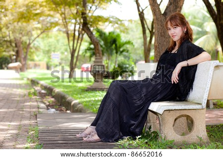 Woman sitting in a lawn chair in the garden
