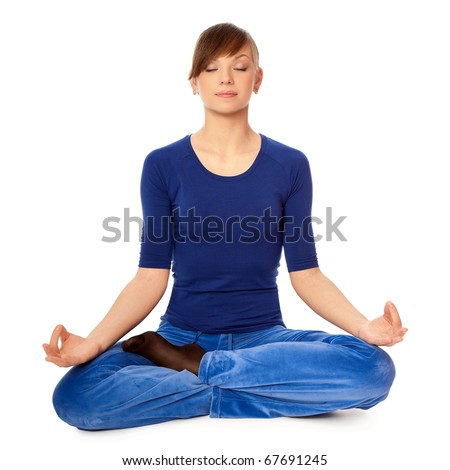 Woman sitting in lotus posture in the health club dressed in blue clothes and meditating