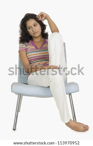 Woman sitting on a chair and looking serious